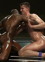 Two naked studs battle all out in oil for sexual dominance.