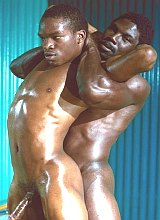 Two black muscle dudes wrestling and cumming gusto