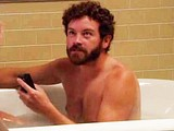 Male celebrity Danny Masterson naked in a bathtube