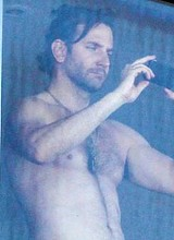 Male celeb Bradley Cooper shirtless on a balcony