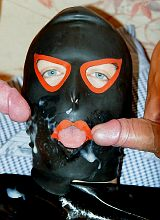 A masked hunk and muscles in jocstraps facial kick