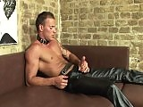 Jimmy Visconti in leather enjoys masturbation on a couch
