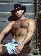 Sucking and drilling a mature hairy chested cowboy