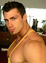 Gorgeous muscle hunk with huge torso posing on cam
