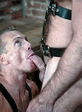 Mature bears in leather having anal fun in dungeon