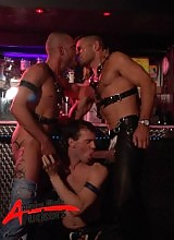 Having had enough of watching Trojan enjoying himself, Carlo heads to a sleazy sex bar, but once three horny leather hunks get to it, he's off, leaving them to it!!