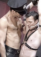Leather hunks  spanking and thrusting in a dungeon