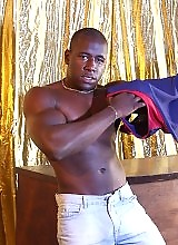 Hunky black stud strips down exposing his huge cock