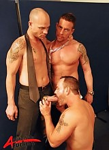 Slowly undressing from their suits, this threemanfest turns the heat up higher than the air condition can manage.