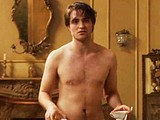 Male celebrity Robert Pattinson flashing her butts
