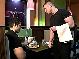 American seduced a muscle European waiter at a bar