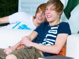 Wild pair of twinks surprising each other on couch