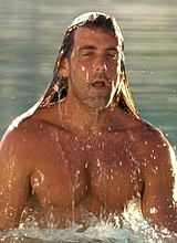 Male celebrity Carlos Ponce exposes cock in speedo