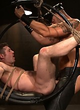 CJ Madison fucks Dean Tucker with his huge uncut cock while Dean is in bondage.