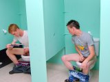 Two horny twinks in public bathroom playing glory!