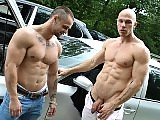 Muscular euro men fuck bareback in a public place