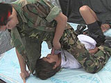Asian soldier stabbing a school boy with his penis