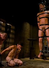 Geoffrey Paine fucks and sucks two ripped studs in bondage.