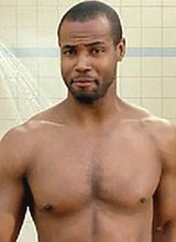 Male celebrity Isaiah Mustafa shows off his body