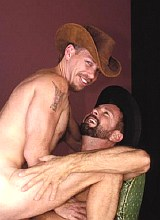 Mature cowboys suck and ride bareback on a hayloft