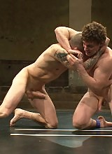 Two big-dicked muscle studs fight for total domination of the mat and the right to fuck their opponents ass in sweet victory.