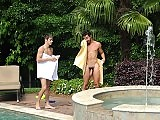 Johnny Rapid enjoys riding big cock by the pool