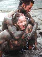 Muscle couple wrestling and thrusting  in the dirt