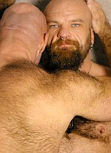 Two chubby mature bears in leather having oral fun