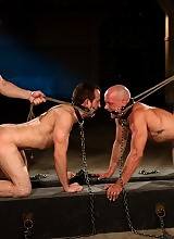 Van Darkholme and Spencer Reed tie up and fuck two naked slave boys.