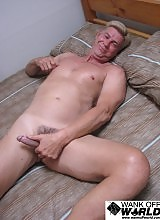 After giving himself a good rub down, he pulled down his track pants to reveal a perfectly erect 7 inch cut cock