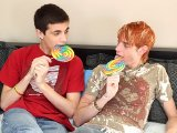 Two adorable twinks munching on pops while banging
