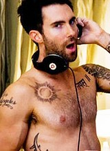 Male celebrity Adam Levine posing completely naked