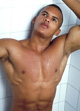 Uncut muscle latin washing in a shower and showing