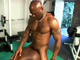 Two muscle black men make sweet anal in gym