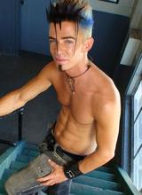 Thin Punk With Mohawk Works His Cock & Balls