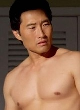 Male celebrity Danie Dae Kim shirtless on a beach