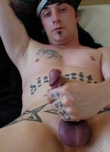 Rocker Dude With Tats and Piercings