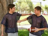 Two cute studs football player engaging into gamin