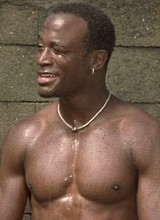 Taye Diggs takes a shower in garden