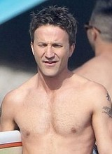 Male celebrity Breckin Meyer shirtless beach shots