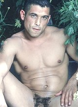 Smooth latino muscle gardener strips and shows off