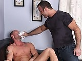 Spencer slips on a condom and plows Mitchs tight hole for an extended fuckfest