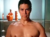 Esai Morales caresses his naked body in a shower