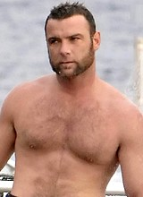 Liev Schreiber shirtless on a beach