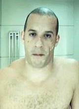 Vin Diesel shirtless in a bathroom